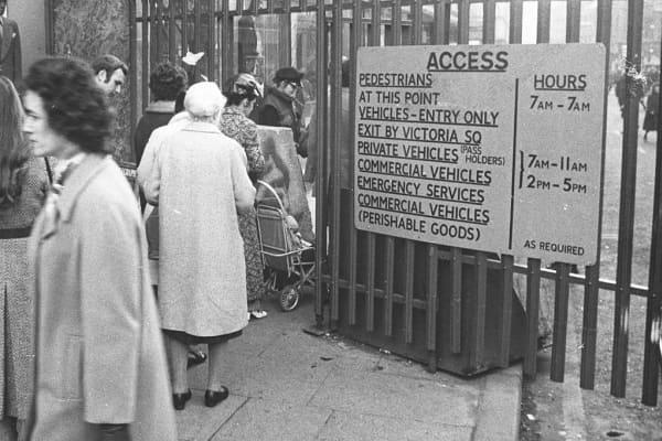 December 1972: Residents of Belfast queuing up at a checkpoint leading out of the city's shopping area. Such checkpoints enable British soldiers to search local shoppers and their bags.