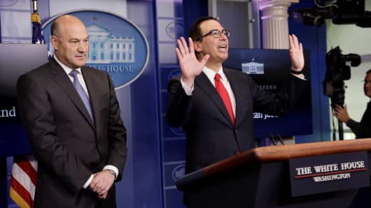 U.S. National Economic Director Gary Cohn (L) and Treasury Secretary Steven Mnuchin end their breifing after unveiling the Trump administration's tax reform proposal in the White House briefing room in Washington, U.S, April 26, 2017.