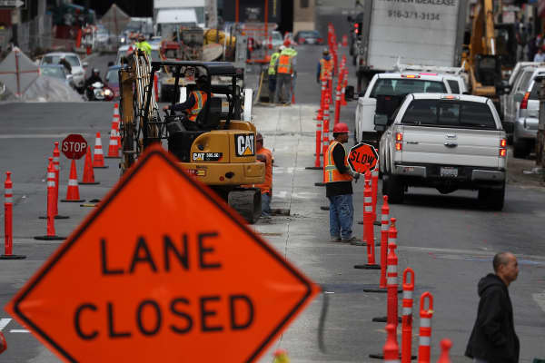 Construction crews conduct repairs on Broadway Street in San Francisco.
