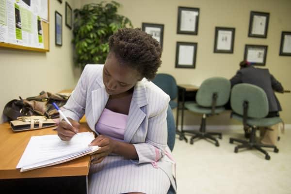 Job seeker fills out an application for temp work at Careerxchange.
