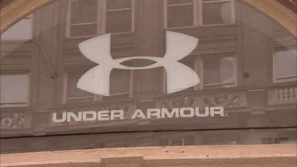 Under Armour shares surge on its first-ever loss