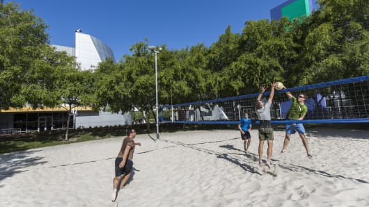 Google employees play some early morning beach volleyball on the Googleplex campus in Mountain View, California.