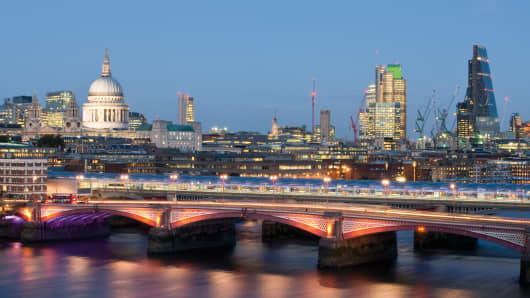 The London skyline at night, with Blackfriars Bridge visible in the foreground