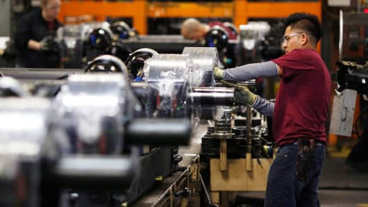 Workers assemble semi trailer components on the factory floor at the Wabash National manufacturing facility in Lafayette, Indiana.
