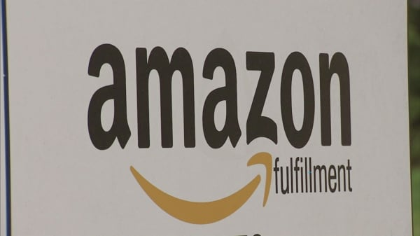 A firm lowered its rating on Amazon to sector weight from overweight
