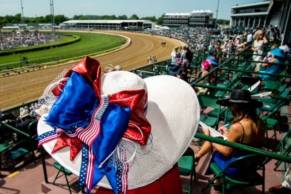 A fan wears a hat decorated with American flags while watching undercard races on Kentucky Derby Day on May 7, 2016 in Louisville, Kentucky.