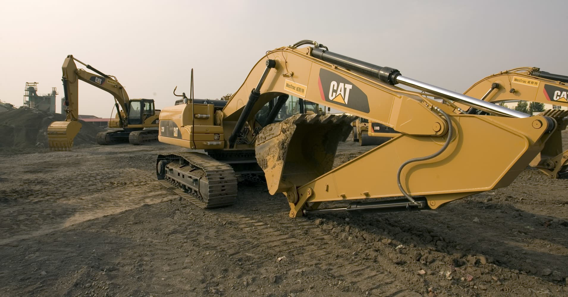 Buy Caterpillar as mining, oil and gas producers replace