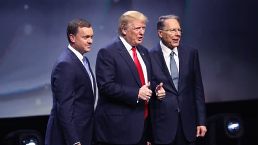 Donald Trump is introduced with Chris Cox (L), Executive Director of the NRA Institute for Legislative Action and Wayne LaPierre (R), Executive Vice President of the National Rifle Association, at the National Rifle Association's NRA-ILA Leadership Forum during the NRA Convention at the Kentucky Exposition Center on May 20, 2016 in Louisville, Kentucky.