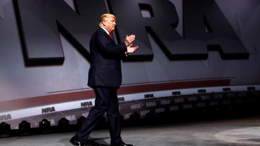 President Donald Trump arrives onstage to deliver remarks at the National Rifle Association (NRA) Leadership Forum at the Georgia World Congress Center in Atlanta, Georgia, U.S., April 28, 2017.