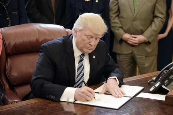 U.S. President Donald Trump signs a Memorandum on Aluminum Imports.