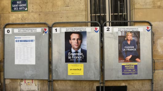 The new 2017 official presidential election posters of the remaining two candidates, Emmanuel Macron and Marine Le Pen, who will compete for the second round.