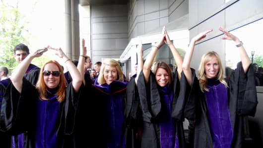 Natalie Bacon (far right) celebrates with friends after graduating from law school.