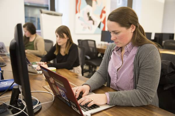 """Rachel Neasham, a travel agent for the booking app Lola, at the office in Boston, Jan. 31, 2017. Lola's artificial intelligence computer system watches and learns from every customer interaction and has a knack for making lightning-fast hotel recommendations. """"It made me feel competitive, that I need to keep up and stay ahead of the AI,"""" Neasham said."""