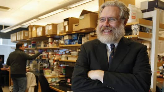 Harvard geneticist George Church poses for a portrait inside his lab at Harvard Medical School.