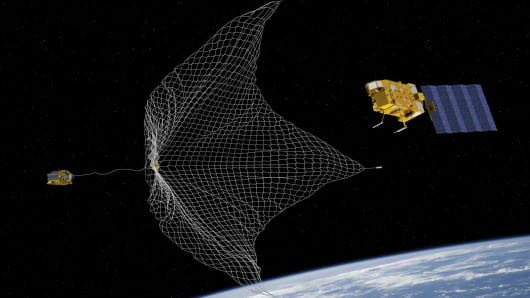 One e.Deorbit concept involves capturing debris in a net attached to a tether.