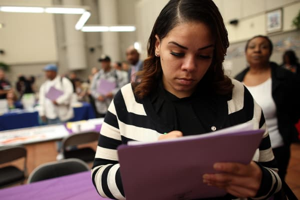 A job seeker fills out an application during a career fair at the Southeast Community Facility Commission in San Francisco, California.