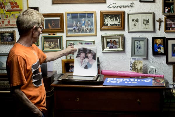 Mike Smith, the father of triplets applying to college, holds a photo of his parents at home in Philadelphia, April 26, 2017. The triplet's mother said all the colleges that accepted her boys wanted them to take out loans, even though a federal financial aid formula found that the family could afford to pay nothing at all.