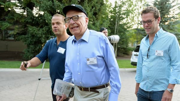 Rupert Murdoch, center, with sons James Murdoch, (R) and Lachlan Murdoch.