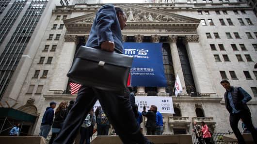Pedestrians pass the New York Stock Exchange in New York.