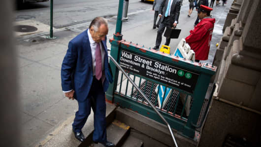 A man enters the Wall Street subway station near the New York Stock Exchange.
