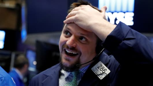 Stocks climb as corporate profits rise, investors await Fed