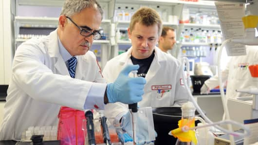 Scientists Dr. Kamel Khalili (L) and Rafal Kaminski prepare DNA cells at Temple University Hospital in Philadelphia, Pennsylvania.
