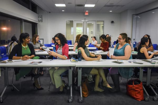 Participants during a role playing exercise during a salary negotiating workshop, sponsored by the Mayors office and the American Association of University Women, to help women negotiate their benefits and salary with more confidence.