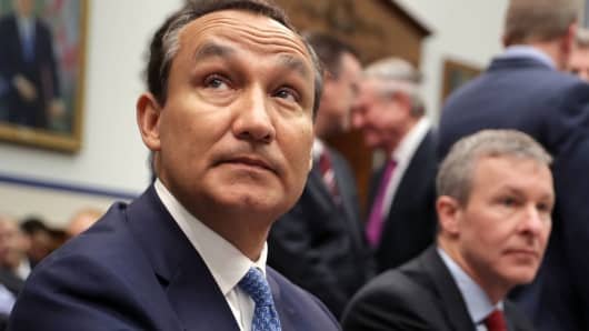 United Airlines CEO Oscar Munoz (L) and United Airlines President Scott Kirby prepare to testify before the House Transportation and Infrastructure Committee about oversight of U.S. airline customer service in the Rayburn House Office Building on Capitol Hill May 2, 2017 in Washington, DC.