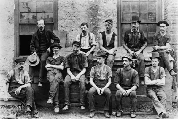 A group of factory workers pictured circa 1890.