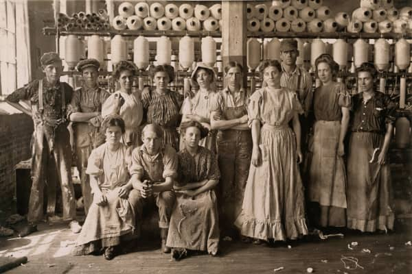 Portrait of group of workers in a cotton mill in Indianapolis, Indiana circa 1908.
