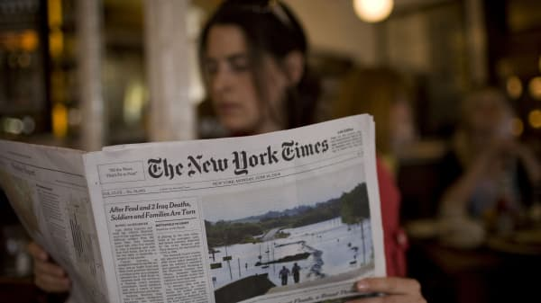 The New York Times being read in New York City.