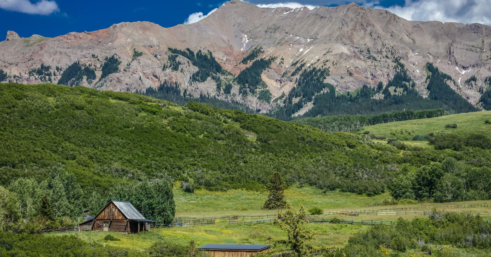 Log Cabin at the foot of the San Juan Mountains in Colorado.