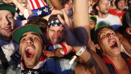American fans celebrate after the U.S. scored to take a 2-1 lead over Portugal while watching a video broadcast at the FIFA Fan Fest on Copacabana Beach during the 2014 FIFA World Cup Brazil on June 22, 2014 in Rio de Janeiro, Brazil.