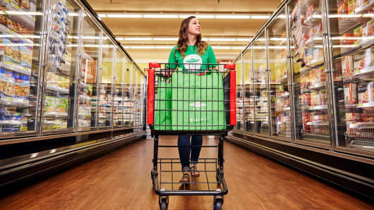 Shipt shopper filling online grocery order at a supermarket.
