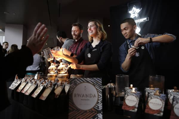Baristas brew siphon coffee at Starbucks' Annual Meeting of Shareholders.