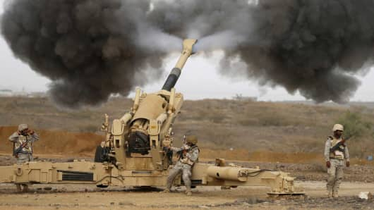 Saudi army artillery fire shells towards Houthi positions from the Saudi border with Yemen April 13, 2015.