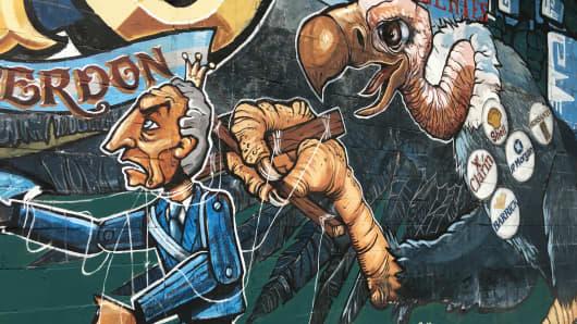 Graffiti taking aim at Argentine President Mauricio Macri on Avenida de Mayo in Buenos Aires, Argentina.