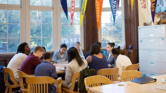 College banners hang in the classroom of teacher Chrys Latham, as she leads a senior advisory period, at Washington Latin Public Charter School, in Northwest Washington, D.C., October 23, 2015.