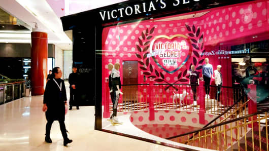 A woman walks past a Victoria's Secret store at Huaihai Road in Shanghai, China.