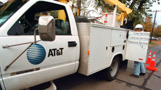 An AT&T advance-line technician parks his service truck as he prepares to troubleshoot an aerial cable in Des Plaines, Illinois.