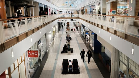 People walk through a nearly empty shopping mall on March 28, 2017 in Waterbury, Connecticut.