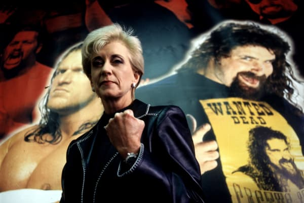 Linda McMahon, President and CEO of the World Wrestling Entertainment poses for a portrait with the federation posters in the background.