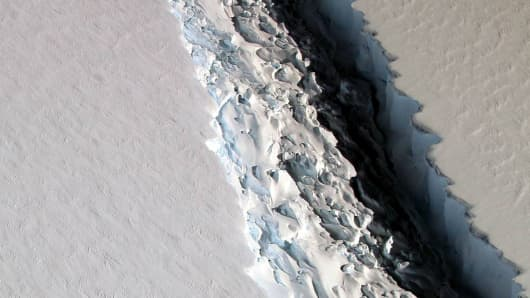 An oblique view of a massive rift in the Antarctic Peninsula's Larsen C ice shelf that finally broke off between July 10 and July 12, creating an iceberg the size of Delaware and destabilizing one of the largest ice shelves in the Antarctic.