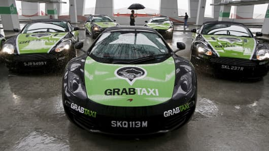 Taxi-booking app GrabTaxi's fleet of seven luxury cars for a photoshoot before they start picking passengers in Singapore.