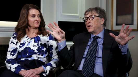 Microsoft co-founder Bill Gates speaks while his wife Melinda looks on during an interview in New York.