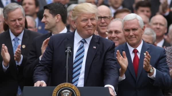 President Donald Trump (C) gathers with Vice President Mike Pence (R) and Congressional Republicans in the Rose Garden of the White House after the House of Representatives approved the American Healthcare Act, to repeal major parts of Obamacare and replace it with the Republican healthcare plan, in Washington, U.S., May 4, 2017.