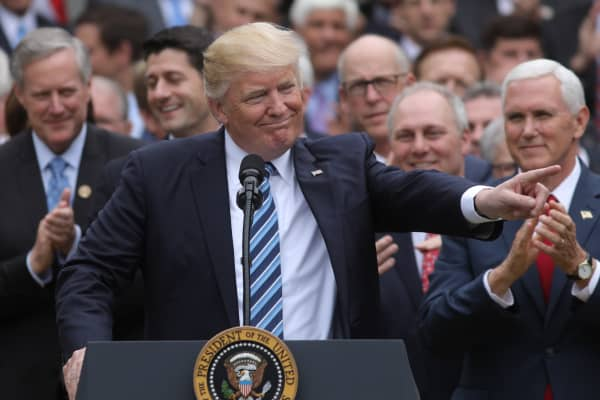 President Donald Trump (C) turns to House Speaker Paul Ryan (3rdL) as he gathers with Congressional Republicans in the Rose Garden of the White House after the House of Representatives approved the American Healthcare Act, to repeal major parts of Obamacare and replace it with the Republican healthcare plan, in Washington, U.S., May 4, 2017.