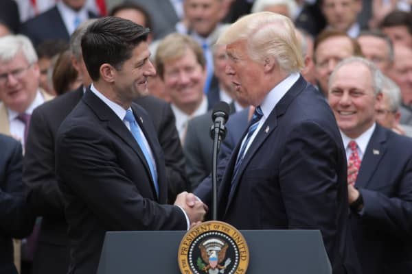 President Donald Trump congratulates House Speaker Paul Ryan (L) as he gathers with Congressional Republicans in the Rose Garden of the White House after the House of Representatives approved the American Healthcare Act, to repeal major parts of Obamacare and replace it with the Republican healthcare plan, in Washington, U.S., May 4, 2017.