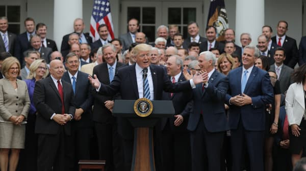 President Donald Trump (C) gathers with Congressional Republicans in the Rose Garden of the White House after the House of Representatives approved the American Healthcare Act, to repeal major parts of Obamacare and replace it with the Republican healthcare plan, in Washington, U.S., May 4, 2017.