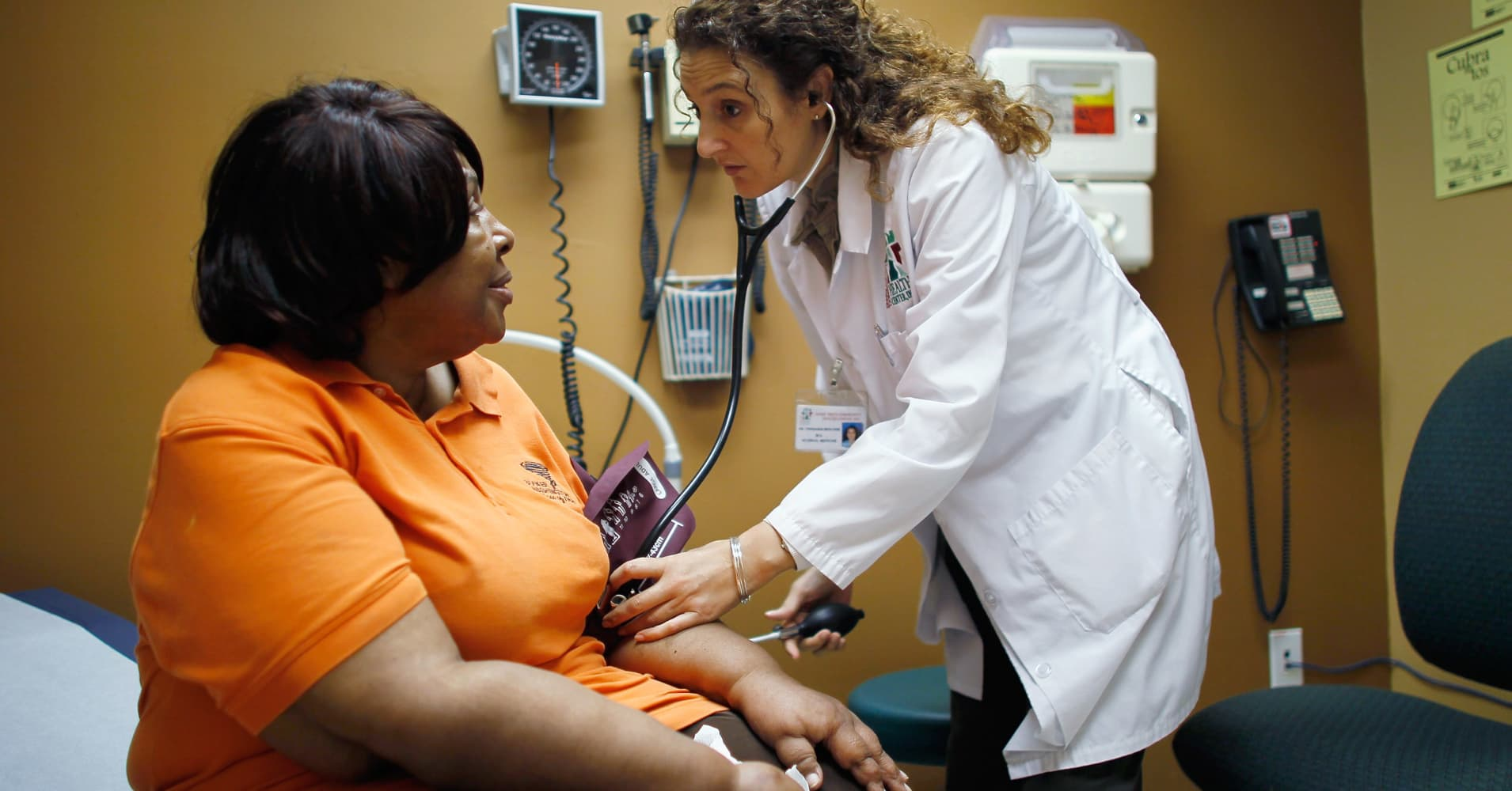 A woman who said she had a pre-existing condition that made it impossible to find insurance that would cover her until the Affordable Care Act, is examined by a doctor during a routine checkup at a community health clinic in Miami, Florida.